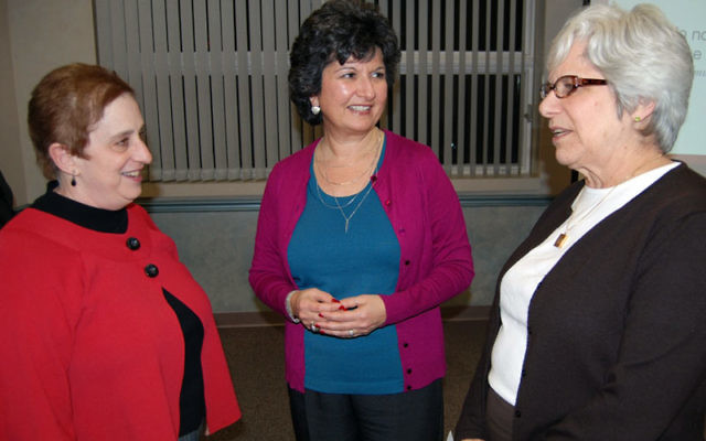After her talk at a job-seekers' workshop, executive coach Karla Robertson, center, talks with JFS counselors Sheri Brown, left, and Carol Einhorn.