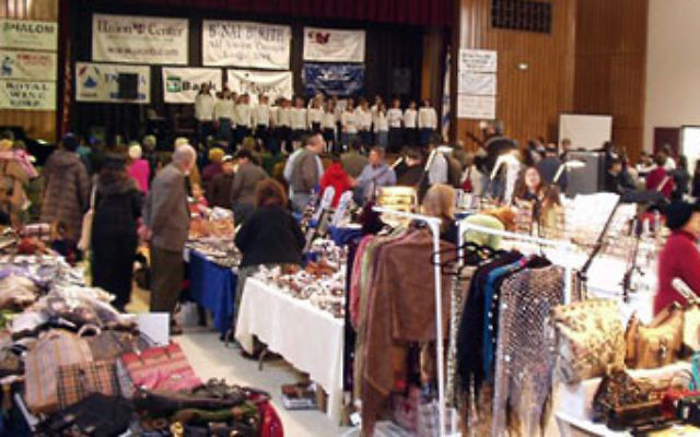 The choir from the Jewish Educational Center Yeshiva sings as shoppers survey the array of vendors' products at the Union Y's annual Jewish Fair and Expo.