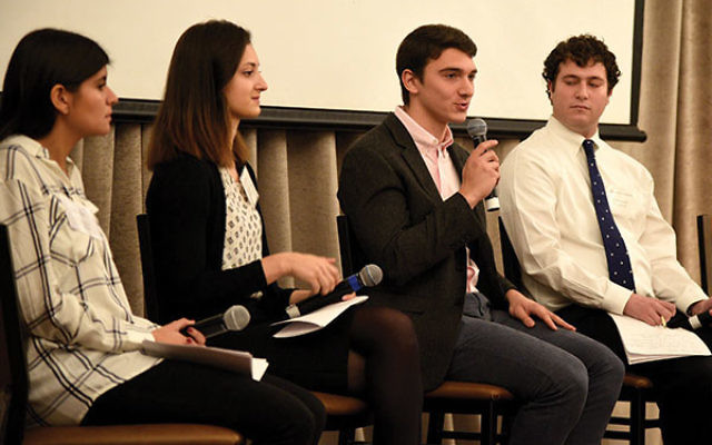 Gabriel Goldstein speaks during a panel on college student experiences.