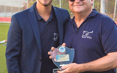 Ivan Cohen of Westfield displays his Israel Premier Lacrosse League Coach of the Year Award with IPLL commissioner Ted Bergman.