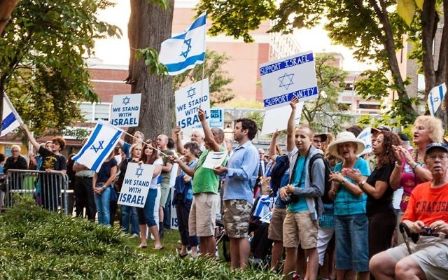 A crowd estimated at 300 gathered August 7 for a rally at the Morristown Green in support of Israel. Photographs by Gary Aidekman.