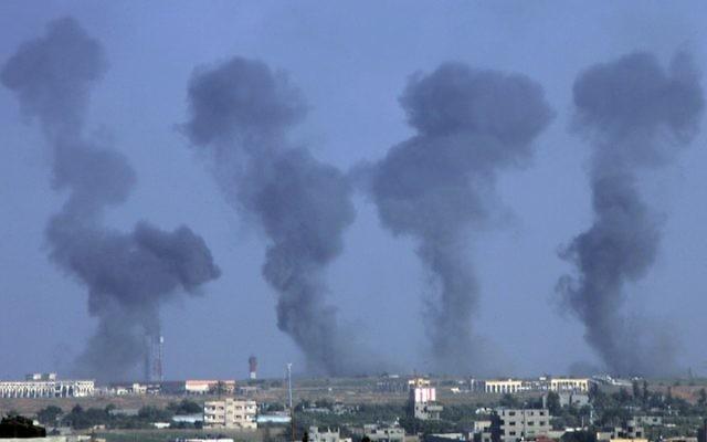 Black smoke rises following an Israeli airstrike on the Gaza International Airport in Rafah, July 7, 2014. (Abed Rahim Khatib/Flash 90)