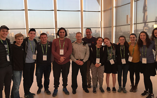 DF Spokesman, Lt. Colonel Peter Lerner posing with the Write On For Israel 2017 students. Courtesy of Julian Biller