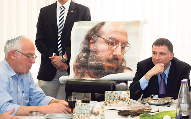 Uri Ariel, left, Israel's minister of housing, and Knesset chair Yuli Edelstein at a Passover seder held in honor of Jonathan Pollard, pictured, at the Knesset, April 8, 2014.