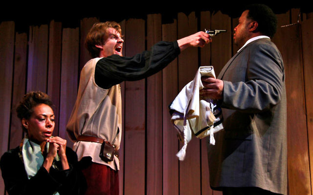 From Under the Cross at the New World Theatre Project: Convert Moshke Ferapontov (Stephen Marcus Naylor, right) is attacked by Russian peasant Akim (Dan Beilinski) for harboring Rohkl Leye (Trish McCall, seated), a Jewish woman who was raped duri
