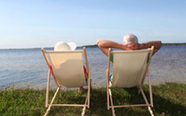Seniors relaxing by a lake
