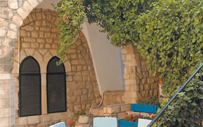 The garden at the hotel Ruth Rimonim Safed echoes the city's distinctive architecture.