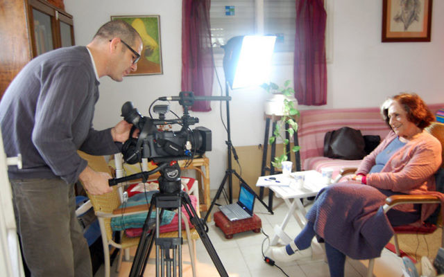 Ruth Farhi, who was a student in Jerusalem in 1948, sits in her Ramat Gan home for an interview with cameraman Peleg Levy of Toldot Yisrael, which is documenting personal recollections of Israel's War of Independence. Photo by Dina Kraft