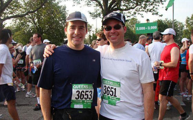 "Stephen Weiss, left — with his brother Dan at the Queens half-marathon last July — said that helping Holocaust survivors ""is an important issue in our family."" Photo courtesy Stephen Weiss"