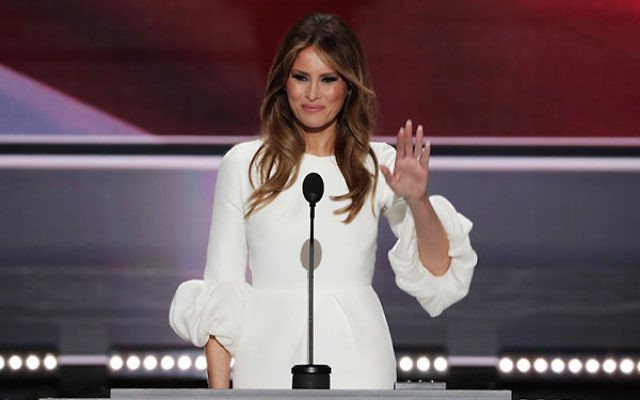 Melania Trump, wife of Republican presidential nominee Donald Trump, waving to the crowd after delivering a speech on the first day of the Republican National Convention at the Quicken Loans Arena in Cleveland, Ohio, July 18, 2016. (Alex Wong/Getty Images