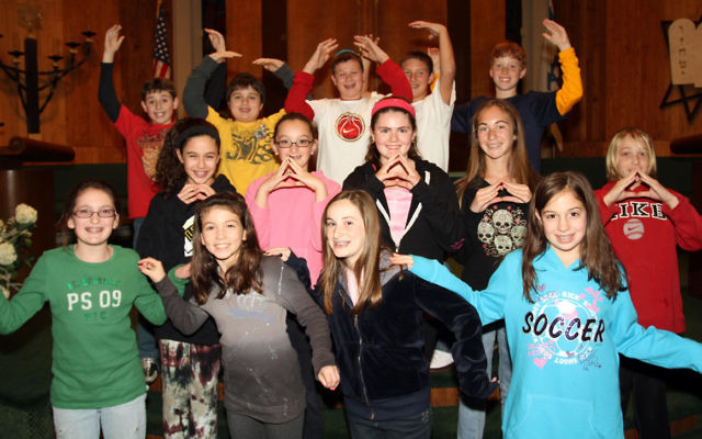 Students at Temple Beth Shalom in Manalapan demonstrate movements that are helping them to learn Torah trope.