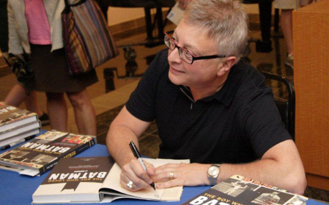 Michael Uslan, producer of six Batman blockbusters, greets friends from his younger days at the Axelrod Performing Arts Center.