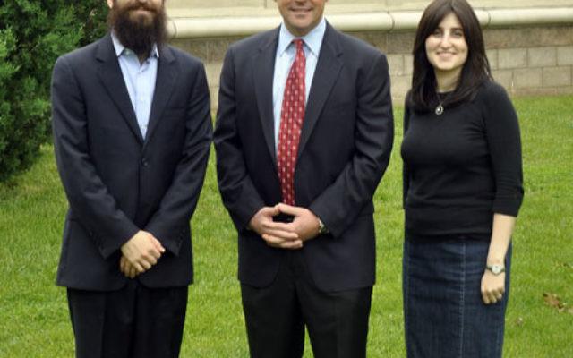Rabbi Yossi and Dina Kanelsky flank Marlboro Mayor Jonathan Hornik May 22 in front of the Center for Jewish Life.