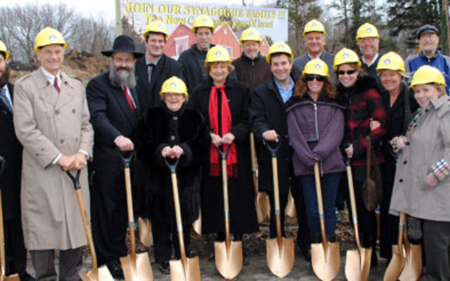 Dignitaries and community leaders — including Monmouth County Freeholder Barbara McMorrow, front row, center — wield golden shovels at the Nov. 27 ground breaking for Congregation Sons of Israel in Wayside.
