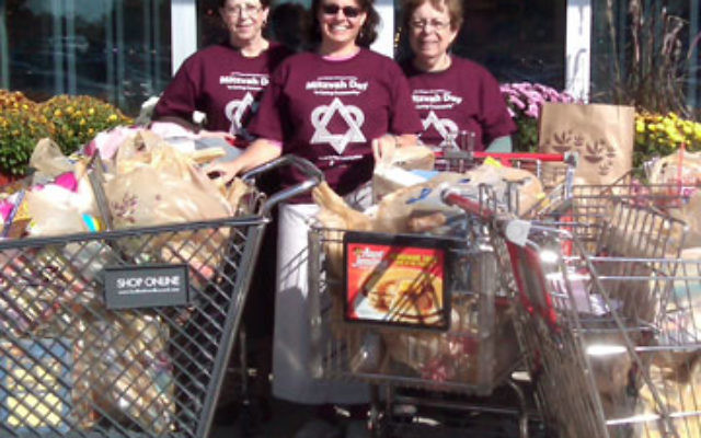 On Mitzvah Day, members of the Young Israel of Aberdeen sisterhood, from left, Thea Byock, Emily Edelstein, and sisterhood president Eleanor Edelstein collected 13 carts of nonperishable items from shoppers at Stop & Shop in Aberdeen to contribute to