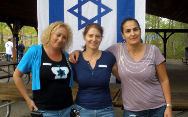About 80 Israelis living in central New Jersey attended the first event of Kesher in Freehold, including, from left, cochairs Raya Benhaim of Highland Park and Tmima Grinvald of Marlboro and committee member Osnat Cudkevich of Marlboro. Photos by Debra
