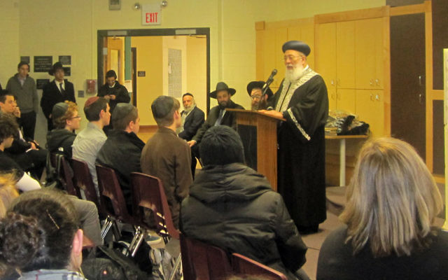 """A school official said students and teachers were """"impressed by the presence and spirituality"""" of Rabbi Shlomo Amar as he spoke to them."""