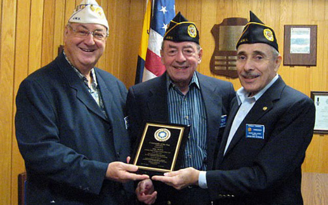 Mel Woda, center, former commander of the Jewish War Veterans Asbury Park-Ocean Post 125, was chosen JWV NJ Commander of the Year. He received his award from NJ State Commander Irwin Gerechoff, left, and new Post 125 commander, Norm Ginsburg.