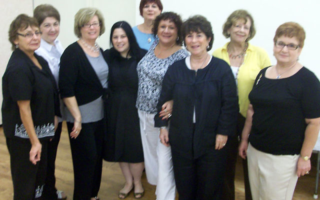 With Sarri Singer, fourth from left, are Ahavat Achim sisterhood members and event organizers at the Sept. 26 Sukka Brunch, including her mother, Judie Singer, third from right, and, from left, Barbara Joel, Roberta Richmond, Nancy Mayrowetz, Marsha Res