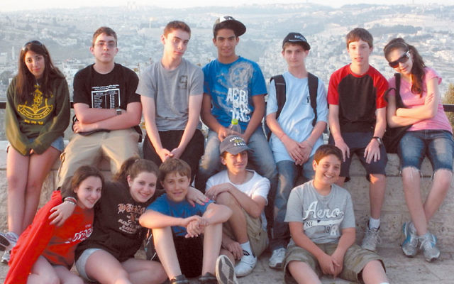 Schechter students take in the view at a promenade overlooking Jerusalem.