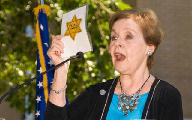 Author Marion Blumenthal Lazan, here addressing a university audience, will tell of her family's survival during a program at Perrineville Jewish Center.