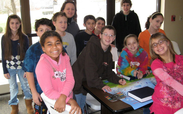 Students take part in the Eco Connection program at Temple Beth Miriam, with fifth-grade Judaic studies teacher Sasha Goldfarb.
