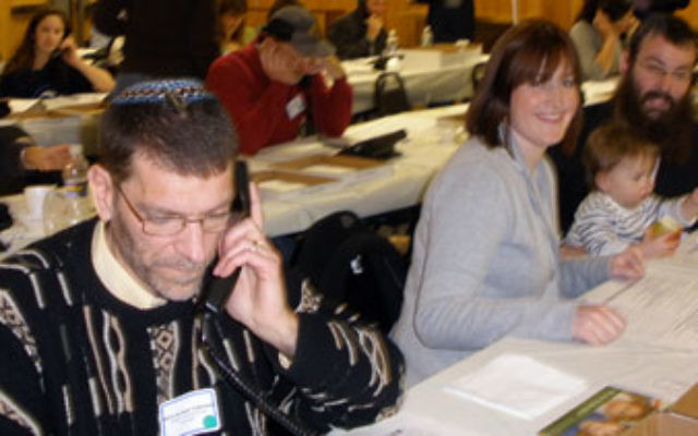 Among the religious leaders of all denominations who volunteered on Dec. 6 at the Jewish Federation of Monmouth County's Super Sunday are, from left, Rabbi Michael Goldstein and Chana'le and Rabbi Levi Wolosow (with their 16-month-old son, Dov