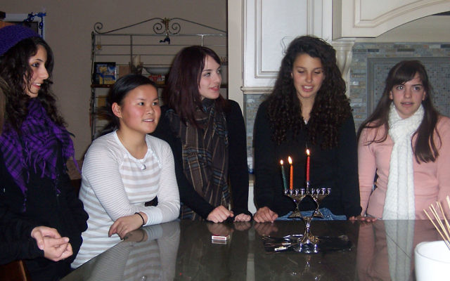 Celebrating the second night of Hanukka during the Israeli teens' visit to Monmouth County are, from left, Neria Aber, teen host Jade Saybolt, Michal Weisman, Chen Avraham, and Nitzan Rubin.