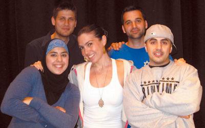 "The Tug of War performers, from left, poets Tahani Salah and Vanessa Hidary, aka ""The Hebrew Mamita,"" DJ Dash Speaks, MC Sneakas, and MC Mazzi. Photo by Allan Goldberg of Coachman Studios"
