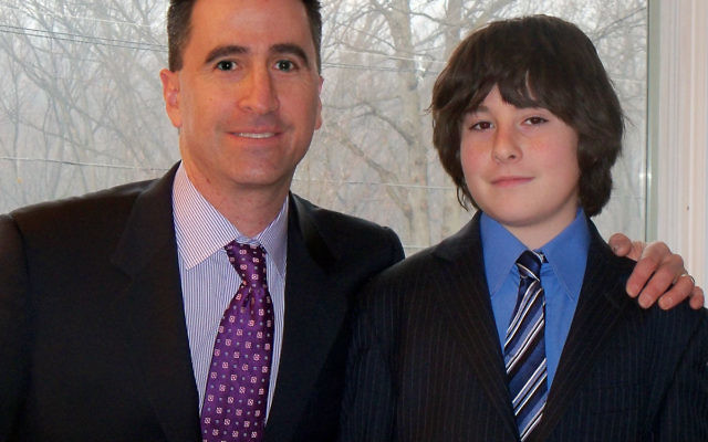 Roland Muller and his son, Jeremy, after their joint bar mitzva service.