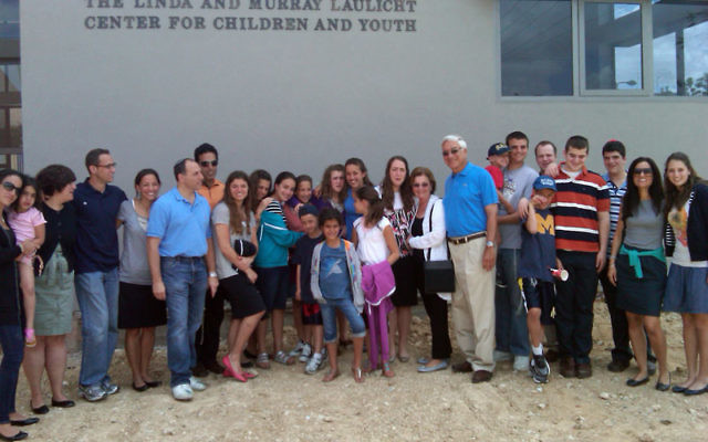 Murray and Linda Laulicht gather with their children and grandchildren at the April 20 dedication of the center named in their honor in the Negev town of Ofakim.