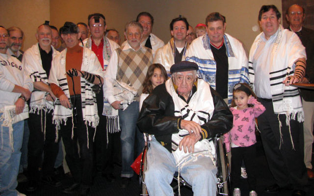 Temple B'nai Abraham men's club members gather after Sunday morning minyan to salute 101-year-old Jack Oelbaum.