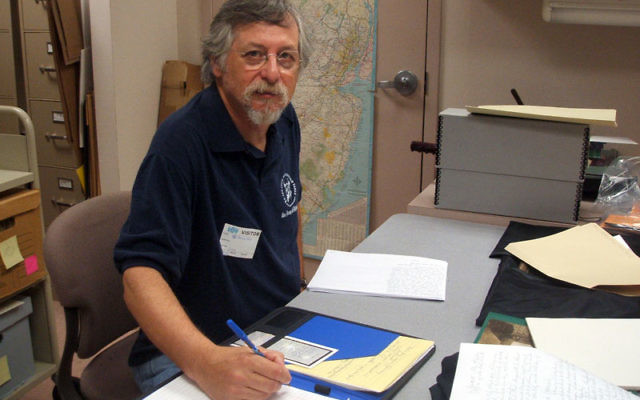 Bruce Form does his research on material he found at the Jewish Historical Society.