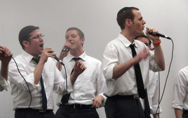 The Maccabeats perform at the Women's Philanthropy annual meeting. Photos by Lori Silberman Brauner