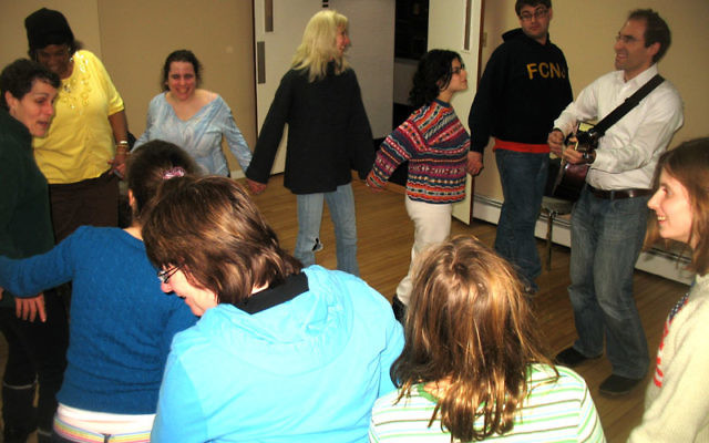 As Rabbi Menashe East plays his guitar, Project Shalem participants dance and sing Jan. 23 at Mount Freedom Jewish Center.