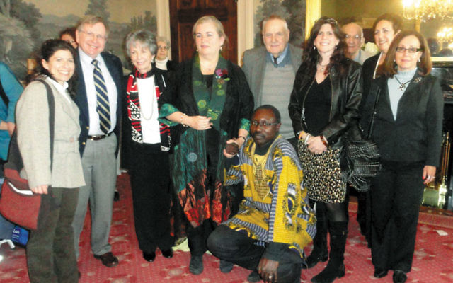 Joyce Reilly, co-convenor of NJ Coalition Responds to the Crisis in Darfur, fourth from left, was honored April 3 at Drew University's Center for Holocaust/Genocide Study; with her are Darfurian national Hisham Osman, front, and, from left, Tobi Ind