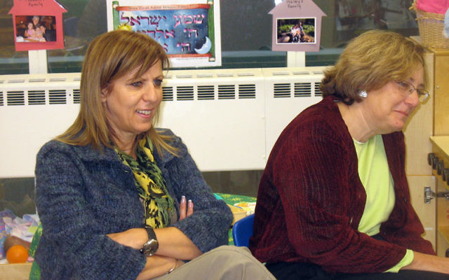 Sima Haddad Ma Yafit, left, of the Israeli Ministry of Education, and Galina Vromen, director of Sifriyat Pijama, Israel's PJ Library program, observed a class of four-year-olds at the Cooperman JCC as part of a visiting Israeli delegation.