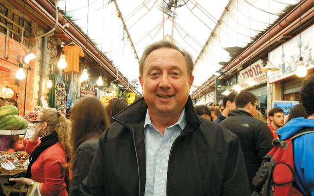 Temple B'nai Or's David Iskovitz in Tel Aviv's Shuk HaCarmel. Photo courtesy David Iskovitz