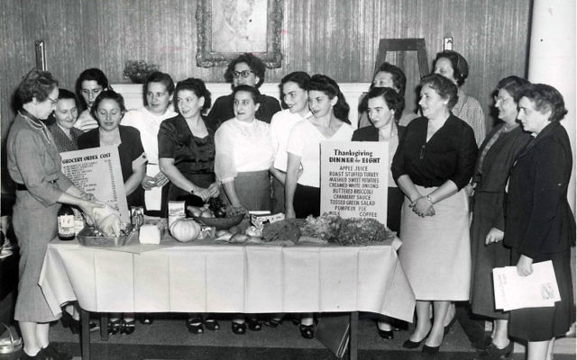 Volunteers from the Bureau of Service to the Foreign-Born, a Jewish social service agency and forerunner to JFS, instruct immigrants to Newark about the American traditions of preparing Thanksgiving dinner, circa 1950. Photos courtesy Jewish Historical