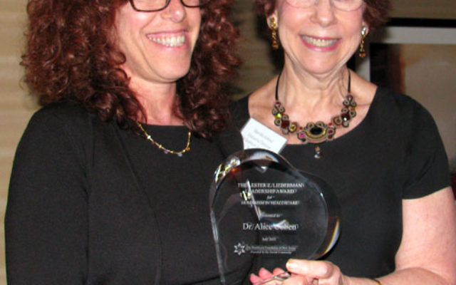 Dr. Alice Cohen, left, receives her Lester Z. Lieberman Leadership Award for Humanism in Healthcare from Marsha Atkind, executive director of the Healthcare Foundation of New Jersey. Photos by Robert Wiener