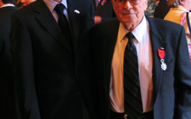 World War II veteran Samuel Brummer, right, after receiving his Legion of Honor of the French Republic medal from French Consul General Philippe Lalliot.