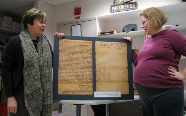Linda Forgosh, executive director of the Jewish Historical Society of MetroWest NJ, left, and JHS archivist Jill Hershorin examine a replica of the society's oldest document — a record from the Essex County Court of Common Pleas regarding sett