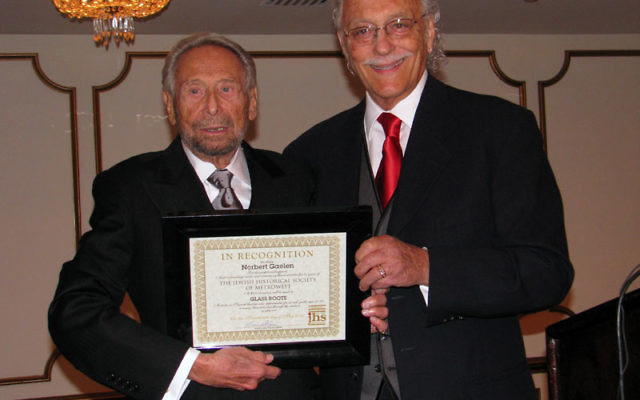 Jewish Historical Society of MetroWest cofounder Norbert Gaelen, left, receives a certificate of recognition from JHS president Howard Kiesel. Photos by Robert Wiener