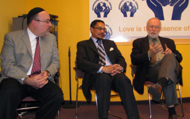 Three clergymen, from left, Rabbi Avi Friedman, Imam W. Deen Shareef, and the Rev. Robert Corin Morris discuss common religious themes in coping with urban problems at Abraham's Table.