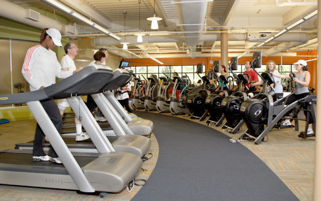 Members of JCC MetroWest's Bildner Family Fitness and Wellness Center in West Orange work out on exercise bikes. Photo courtesy JCC MetroWest