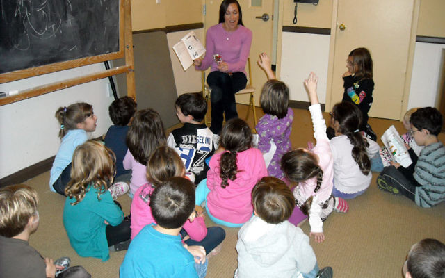 Alexis Gruber, the JCC's Jewish educator for children and families, tells students a Torah story during a class at the GAN program. Photo courtesy JCC MetroWest