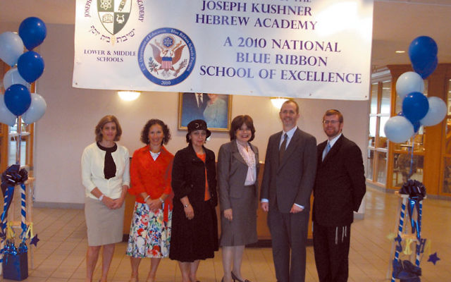 Administrators at the Joseph Kushner Hebrew Academy, standing under their banner proclaiming their Blue Ribbon School status, are, from left, Debbie Finkelstein, middle school associate principal; Shari Faleck, lower school director of student services;