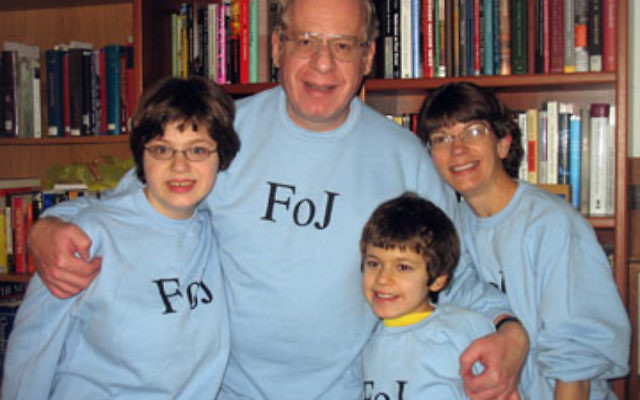 "Jenny Rose, left, and her family — parents Jonathan and Gayle and sister Flora — sport the ""FOJ"" or ""Friends of Jenny"" sweatshirts that were given to guests at her bat mitzva celebration."