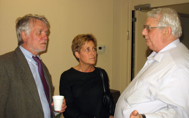 Leonard Robinson, executive director of NJ Y Camps, right, speaks with Dr. Peter H.R. Green and Cynthia Beckman, leaders of the Celiac Disease Center at Columbia University, at the Jan. 5 NJ Y Camps board meeting at the Cooperman JCC in West Orange.