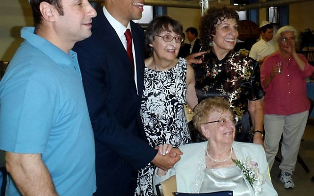 Celia Arons, front, is joined at her 100th birthday party by, from left, Ahavas Sholom president Eric Freedman, Mayor Cory Booker, and her daughters, Harriet Baker and Susan Sullivan. Photo by Ellen Goldner